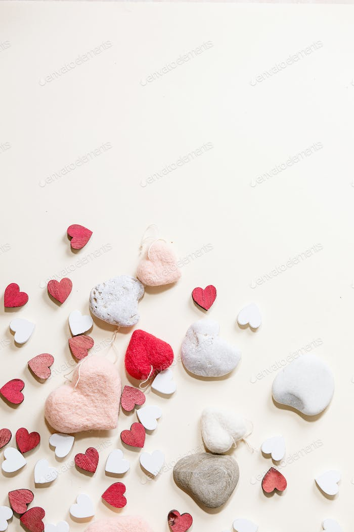 Valentines day background with small wooden hearts