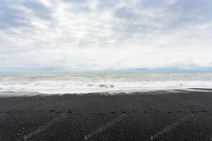 ocean surf on Reynisfjara black Beach in Iceland