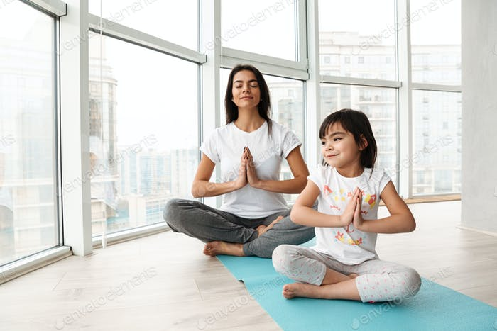 Relaxed people woman and kid practicing yoga indoor, sitting leg