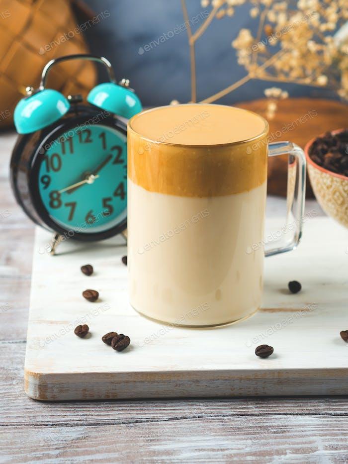Whipped dalgona coffee drink in glass mug