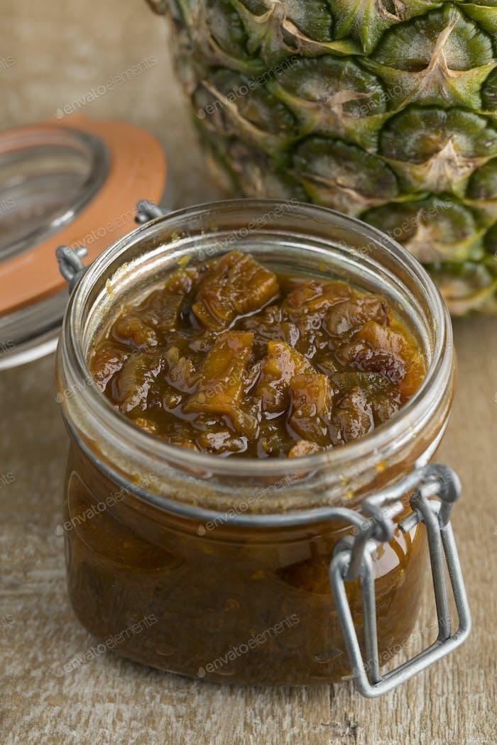 Glass jar with pineapple chutney