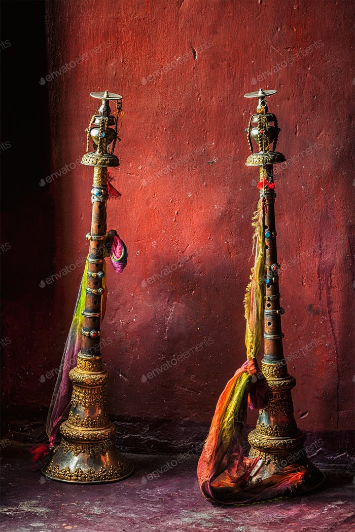Buddhist prayer horns in Tibetan monastery