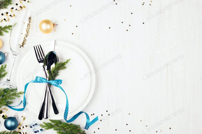 Christmas Setting Table with Blue and Golden Decorations on White Background.