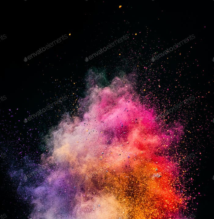 Holi powder exploding on black background.