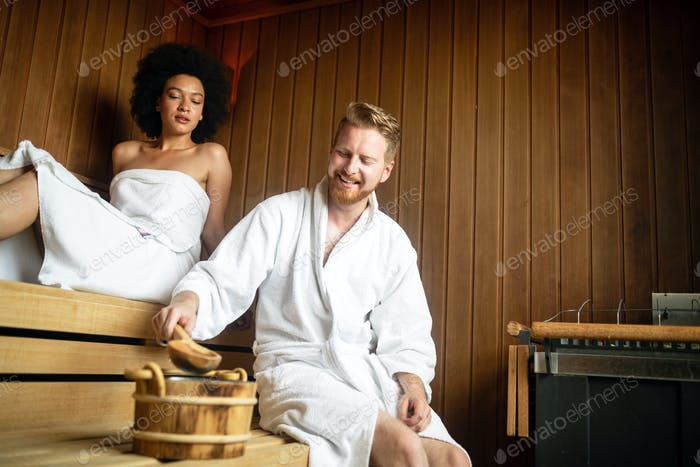 Young happy couple relaxing at spa resort hotel luxury. Relax, love, lifestyle concept