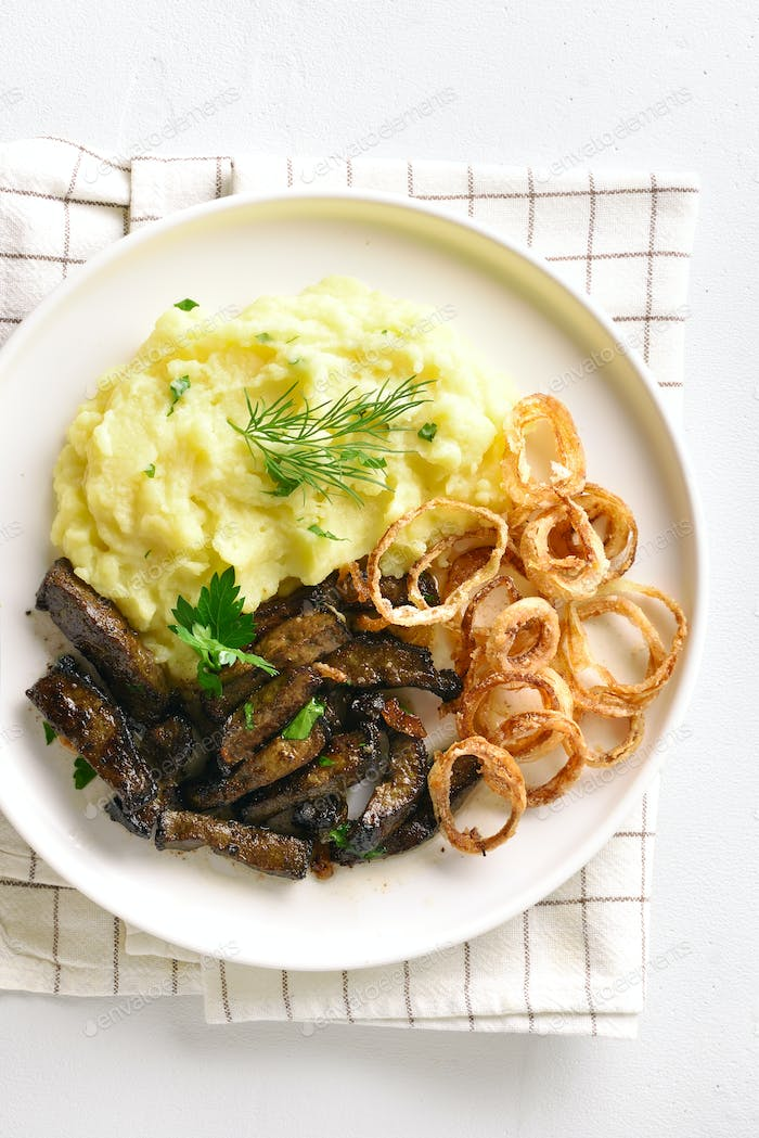Beef liver with mashed potatoes and onion