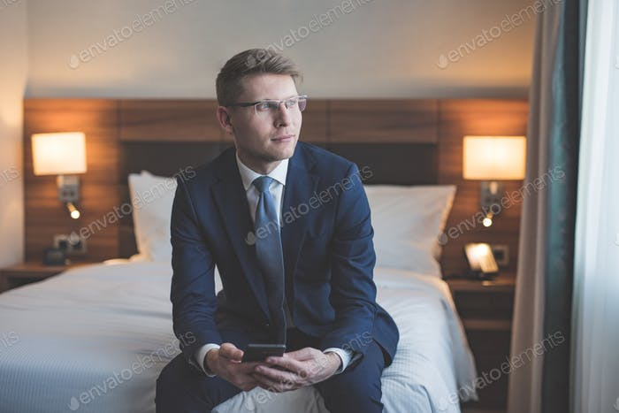 Young businessman in bedroom