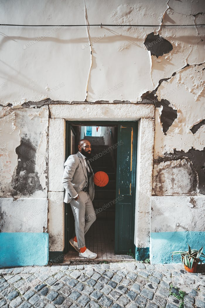 African man with ball in the doorway