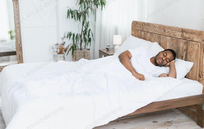 Black Guy Resting Sleeping Lying With Eyes Closed In Bedroom