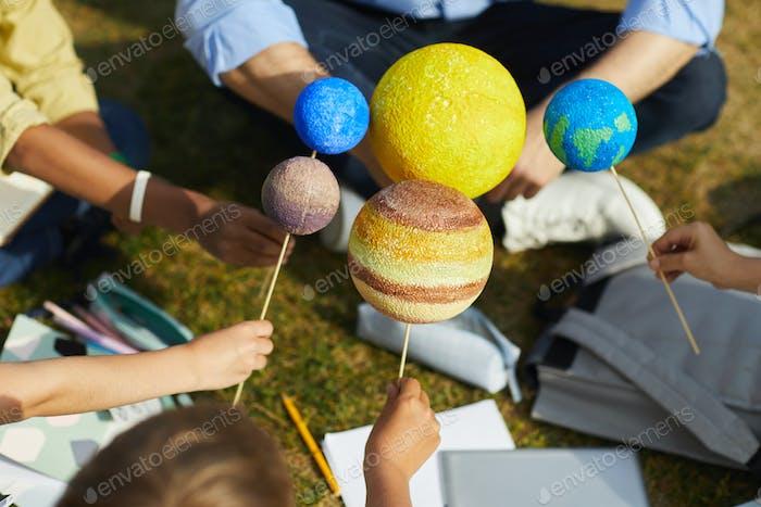 Kids Enjoying Astronomy Lesson Outdoors