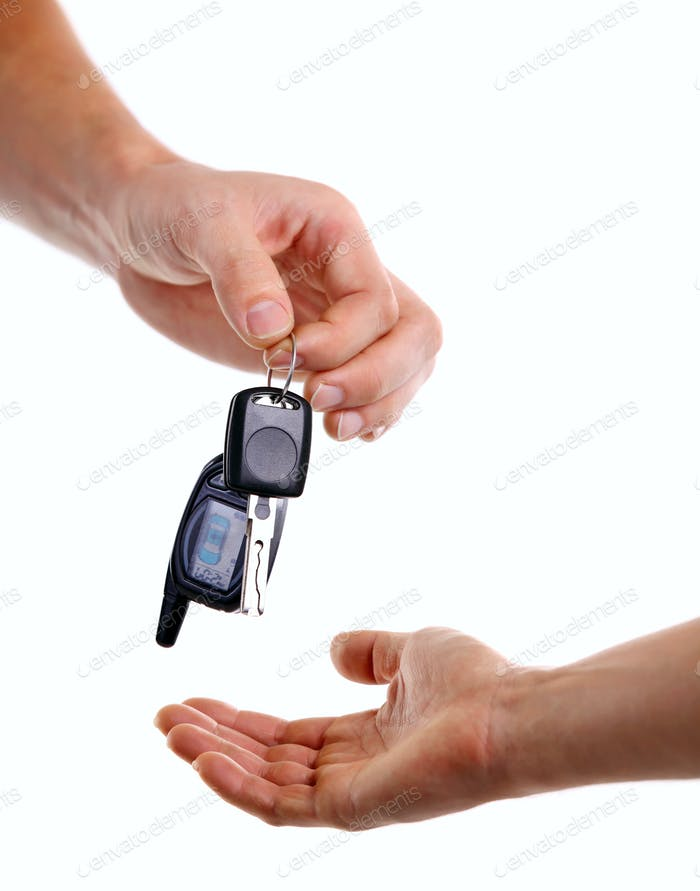 Male hand handing over key to another person