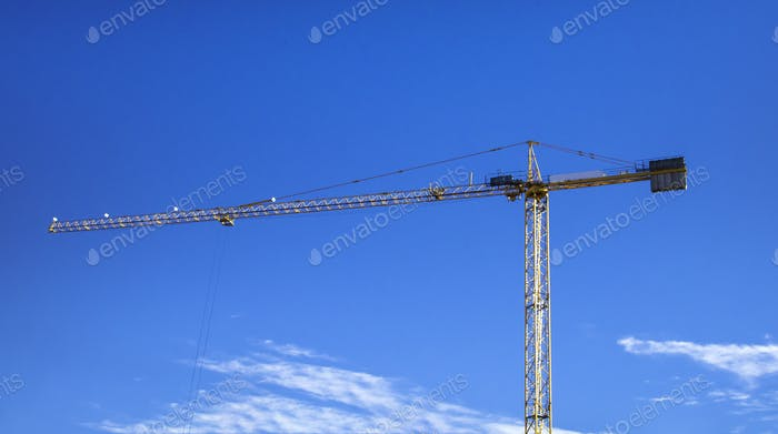 Construction crane Huge crane against blue sky Self-erection crane Tower crane