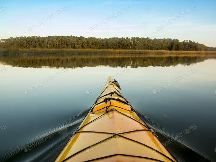 kayaking on glassy water