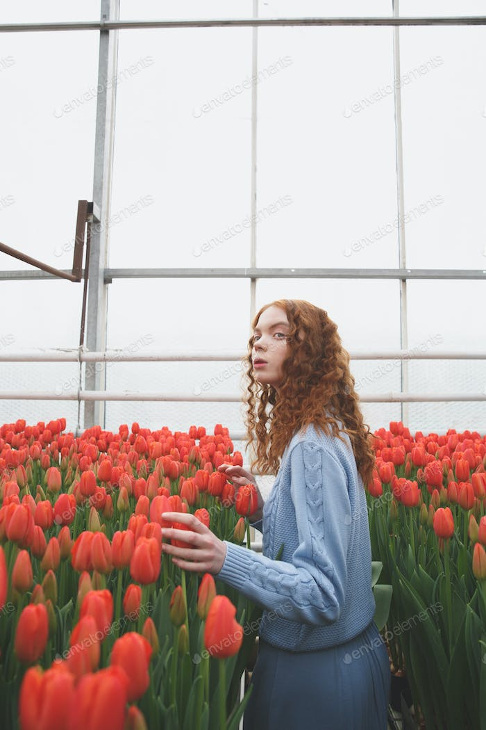 Girl looking up in orangery