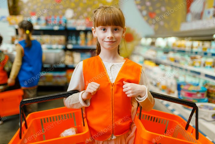 Girl in uniform with baskets in hands, playroom