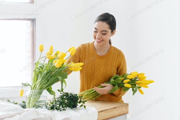 Woman with tulips. Young brunette girl with yellow flowers tulip natural portrait lifestyle