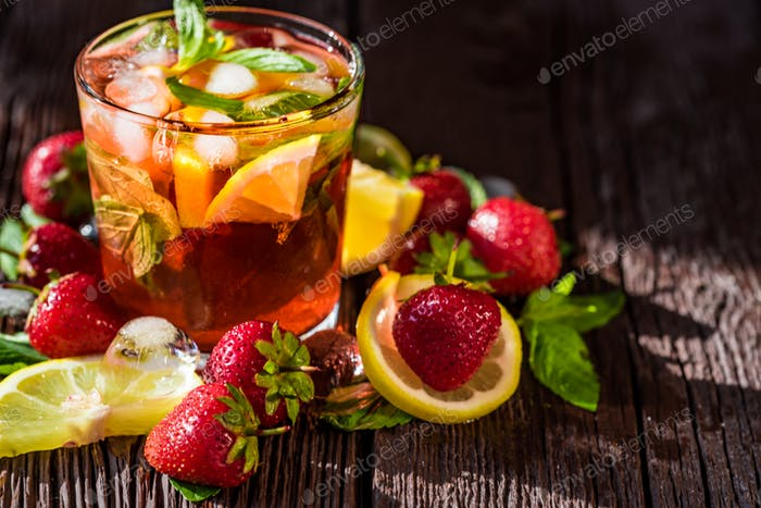 Homemade srawberry mojito and berries on wood