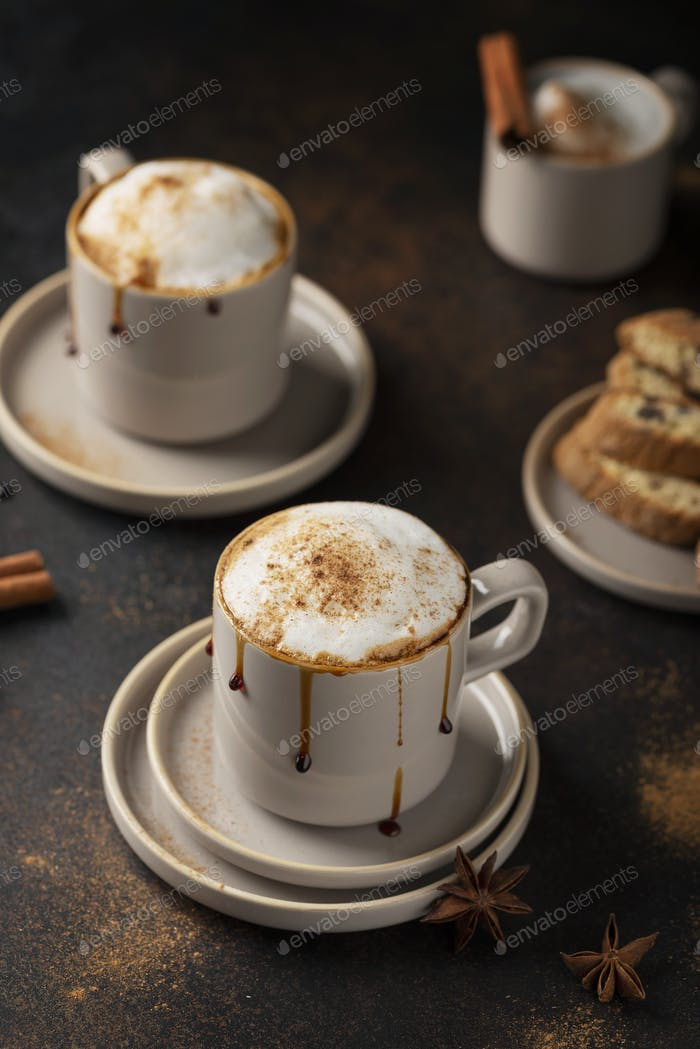 Hot winter cappuccino with cinnamon and caramel