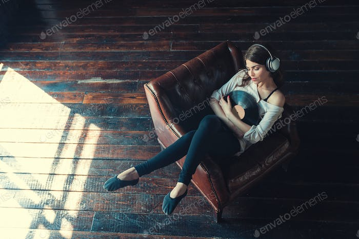 Young woman listen to music indoors