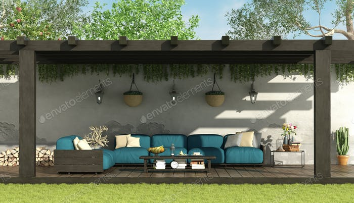 Blue sofa under a wooden pergola