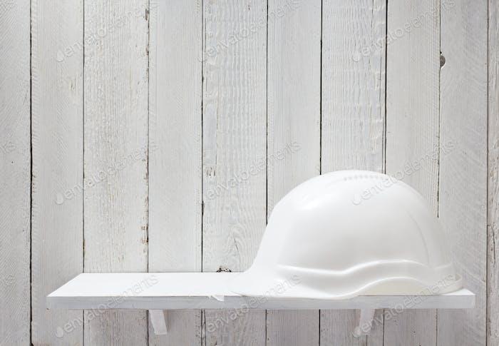 construction helmet on shelf
