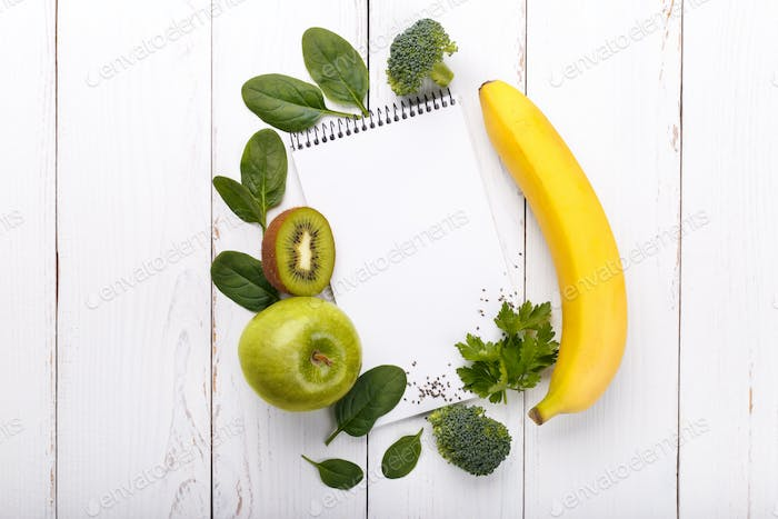 Open notepad and smoothie ingredients