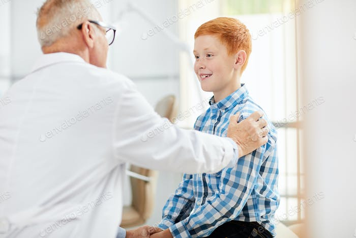 Friendly Doctor Consulting Child