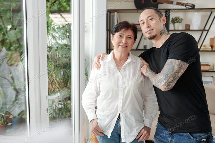 Asian mother with her son at home