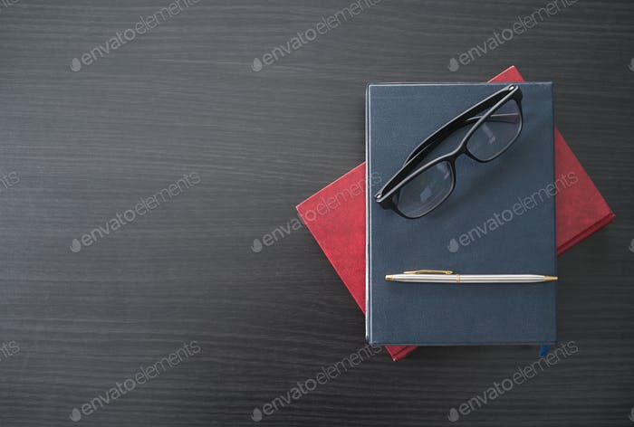 Glasses and book on the wood desk-5