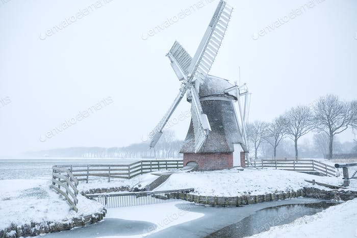 Dutch windmill during wintry snowfall