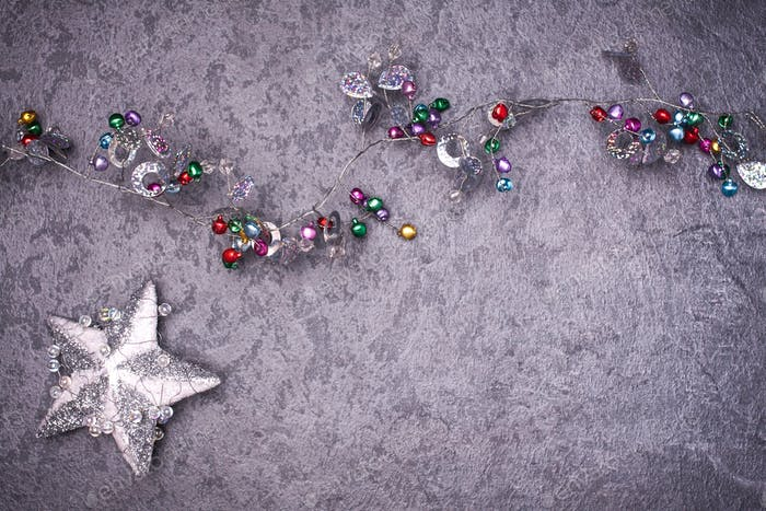 Weihnachts-Grußkarte Noel festlicher Hintergrund. Neujahrssymbol. Stern. Kopieren Sie den Raum in Ihren Text.
