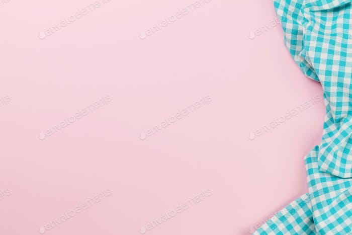 Blue kitchen towel on pink background