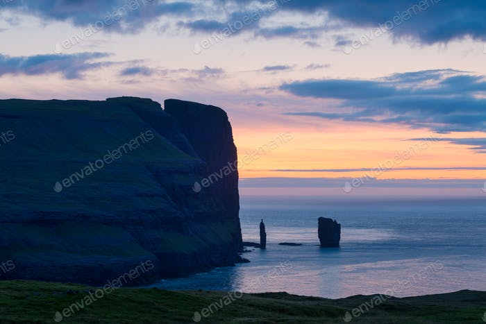 Incredible sunrise morning view on Risin og Kellingin cliffs