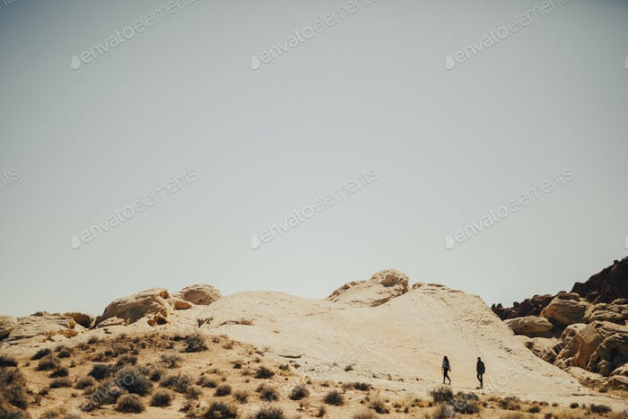 Couple walking in the Death Valley in California, United States