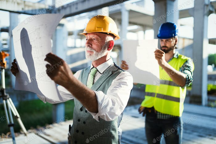 Team of business people in group, architect and engeneer on building site check documents