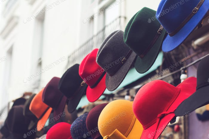 stand with colorful hats on store entrance