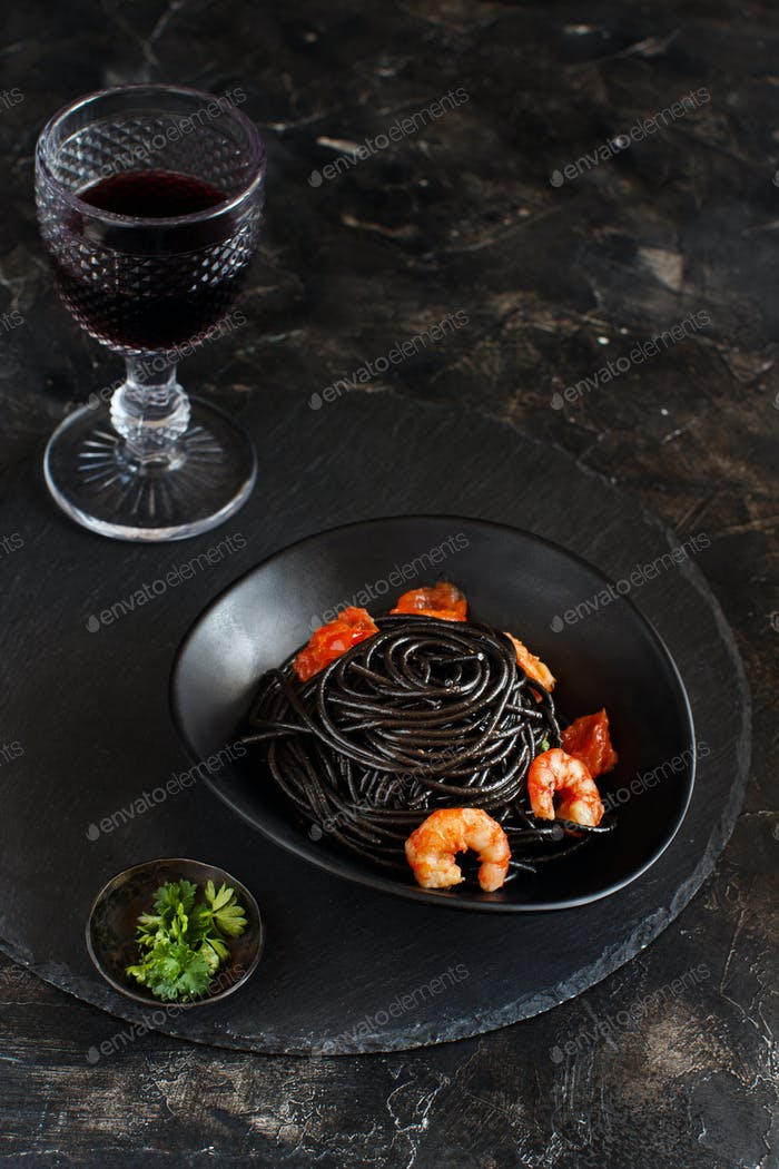 Squid ink pasta with prawns and tomatoes