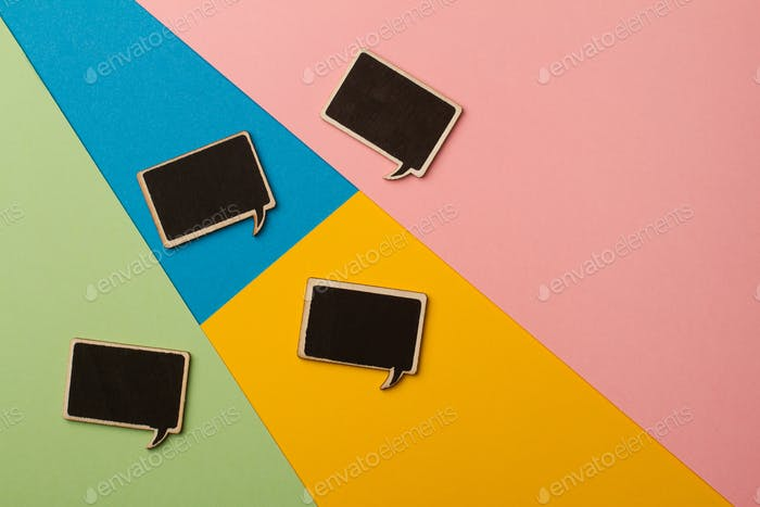 Square empty chalk board speech bubbles on colored papers