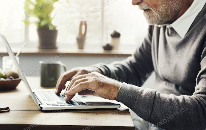 Senior Man Smart Leisure Social Media Typing Concept