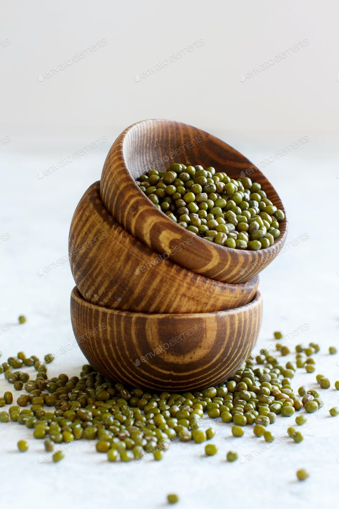 Dried mung beans in wooden bowls