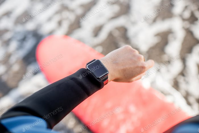 Surfer using smart watch