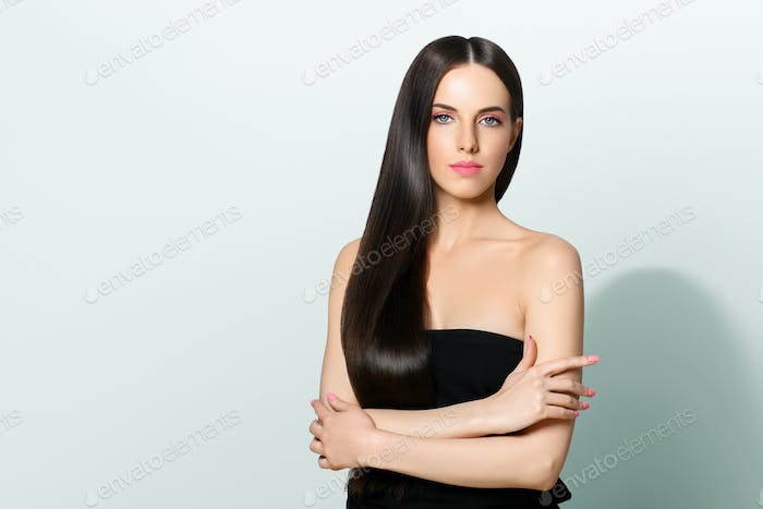 Closed brunette with long shine smooth hair beauty face woman.