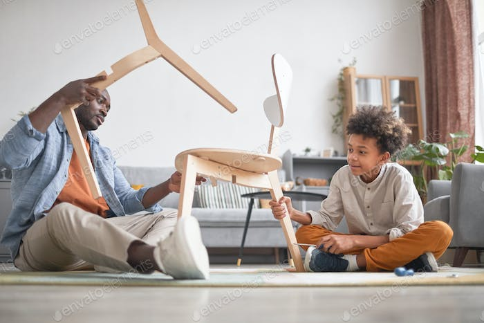 Father And Son Repairing Chair