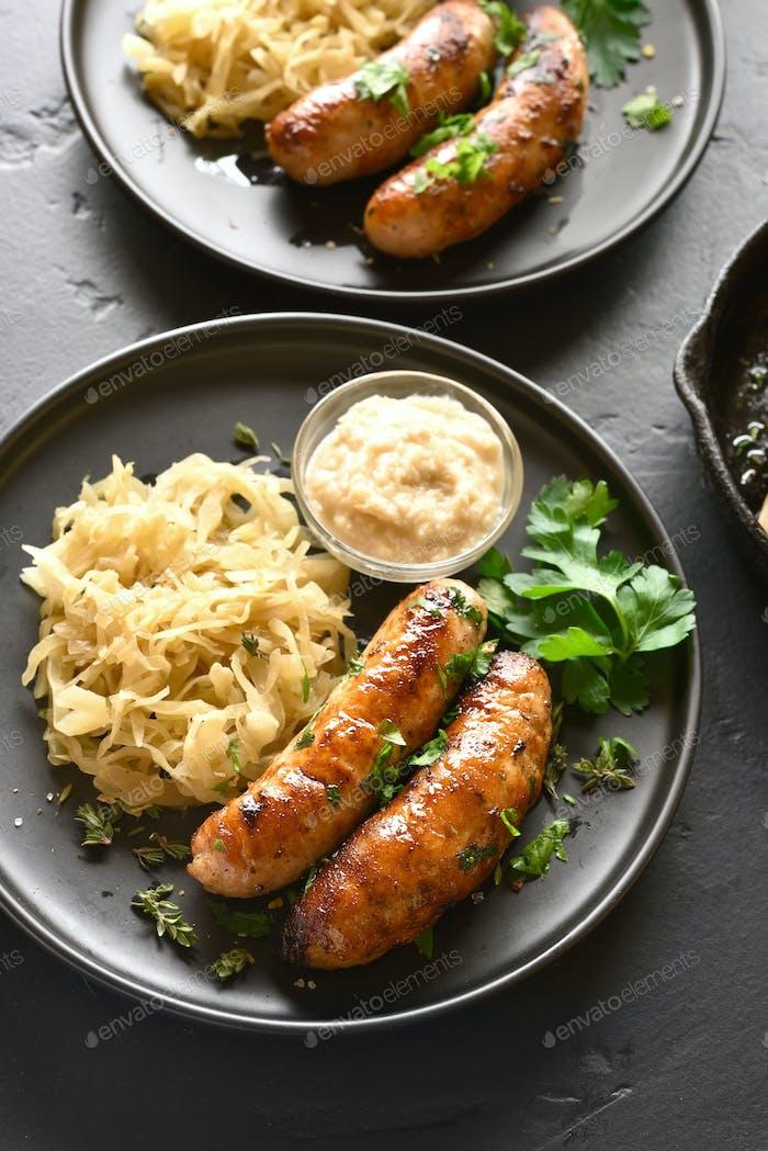Fried sausages with sauerkraut and horseradish
