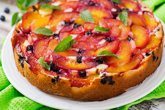 Delicate biscuit pie with peaches and blueberries.
