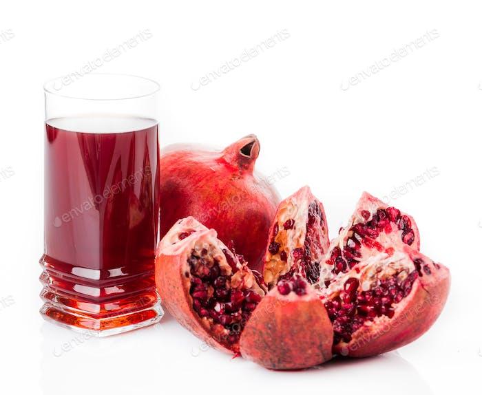 pomegranate juice with fruit isolated on white
