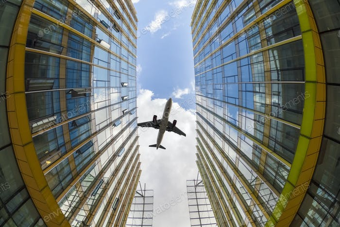 modern glass buildings and airplane