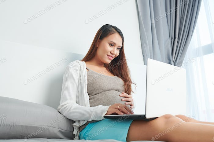 Woman reading about pregnancy