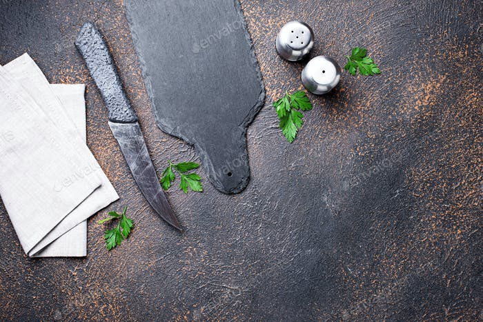 Culinary background with spices, knife and cutting board