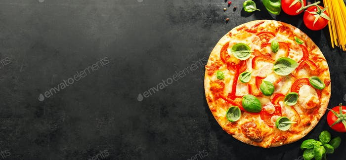 Tasty vegetarian pizza on dark background